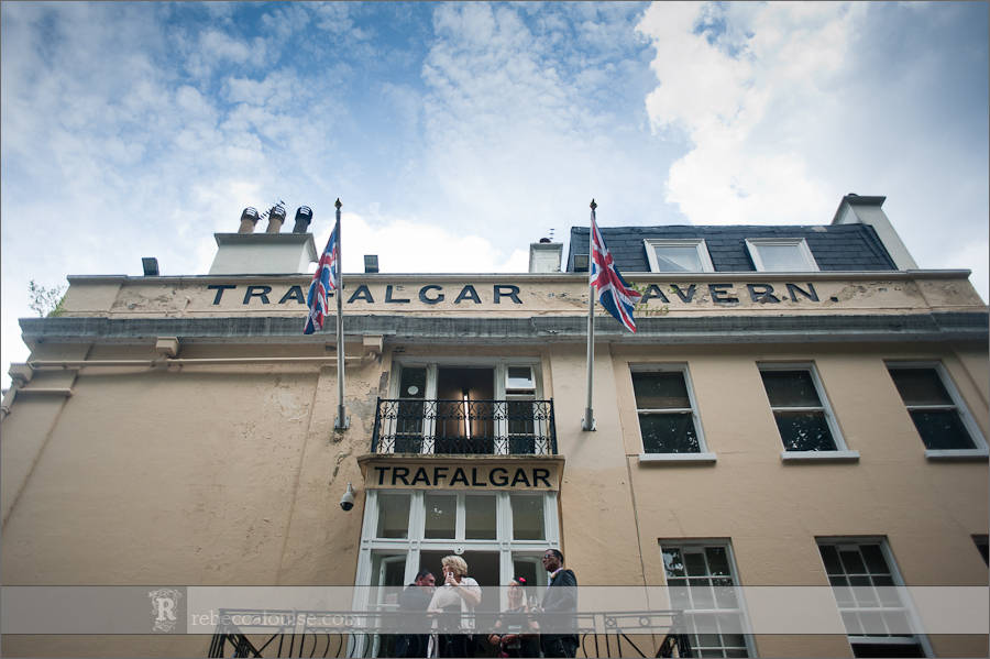 Guests on the balcony for a summer Trafalgar Tavern wedding in Greenwich