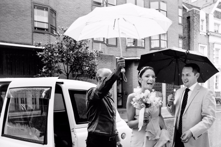 Chelsea Register Office bride arriving for civil wedding ceremony in rain