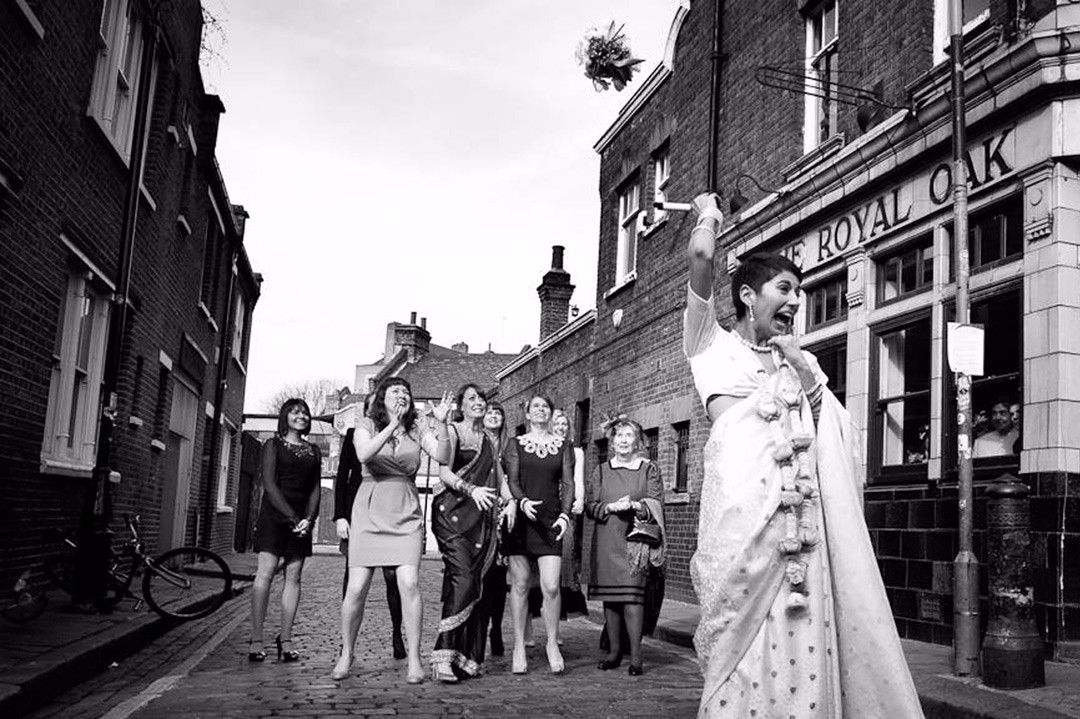 London bride throws bouquet outside Columbia Road pub The Royal Oak
