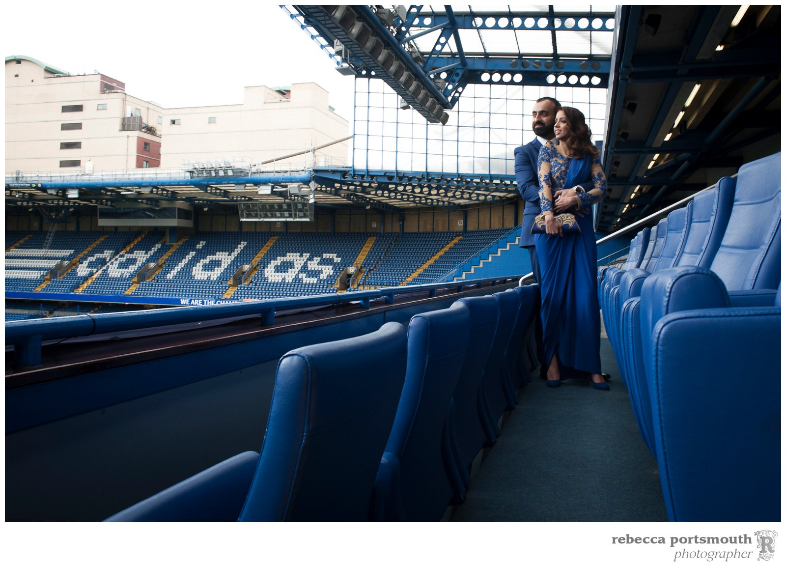 Chelsea Football Club wedding portraits of the bride and groom in the stands overlooking the grounds.