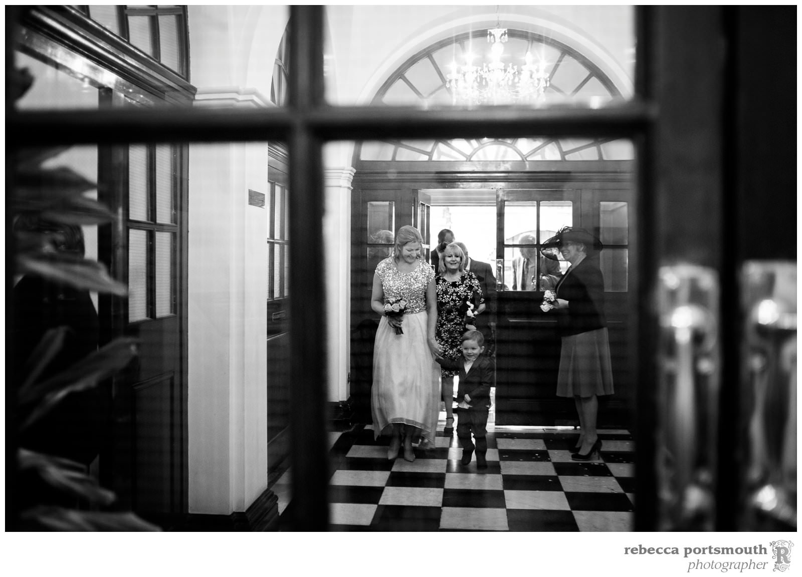 The bride and son arriving at Chelsea Registry Office for her wedding in the Rossetti Room