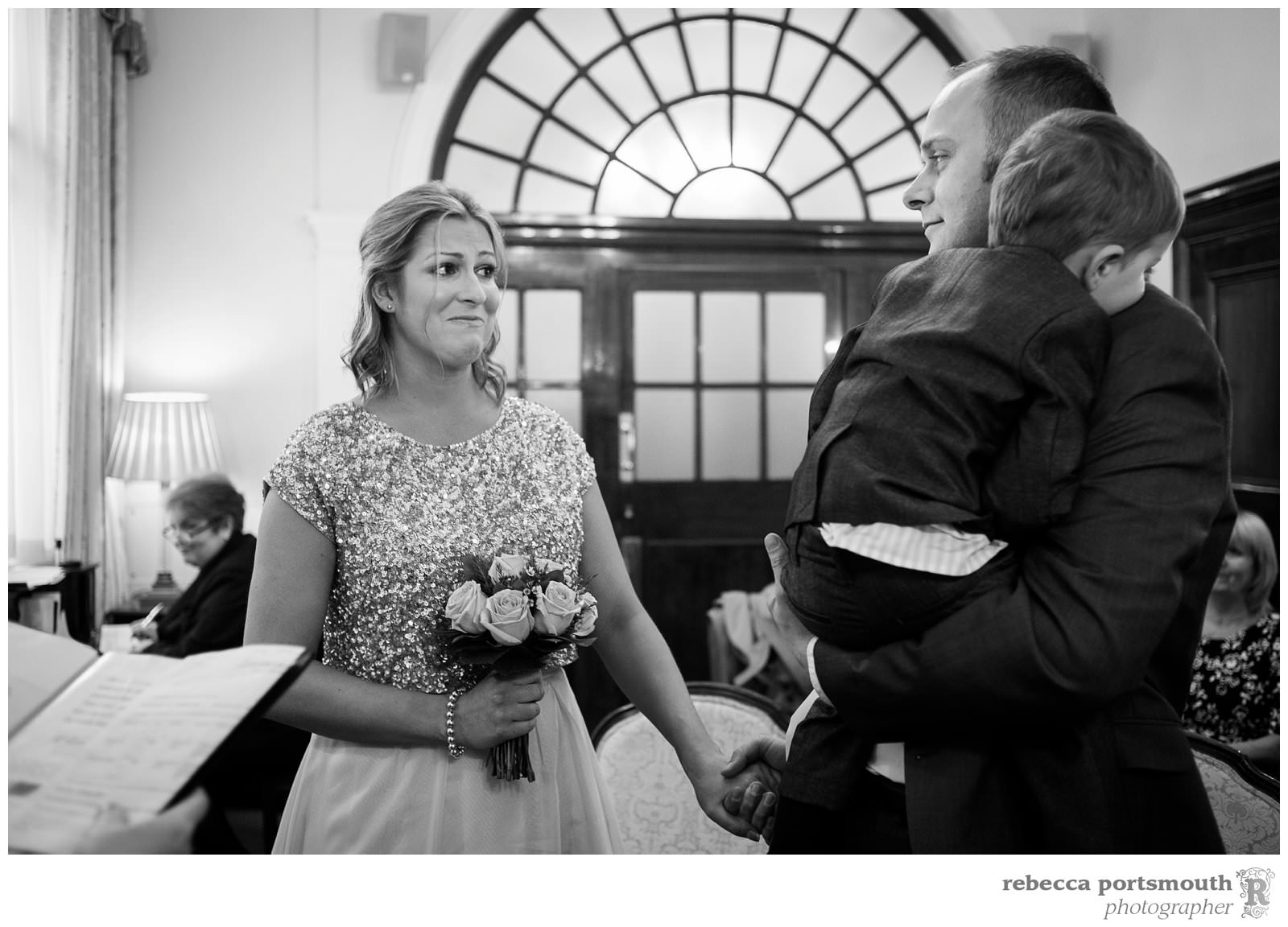 The Chelsea Registry Office wedding photos of Victoria + Dominic: an emotional moment during their ceremony in the Rossetti Room