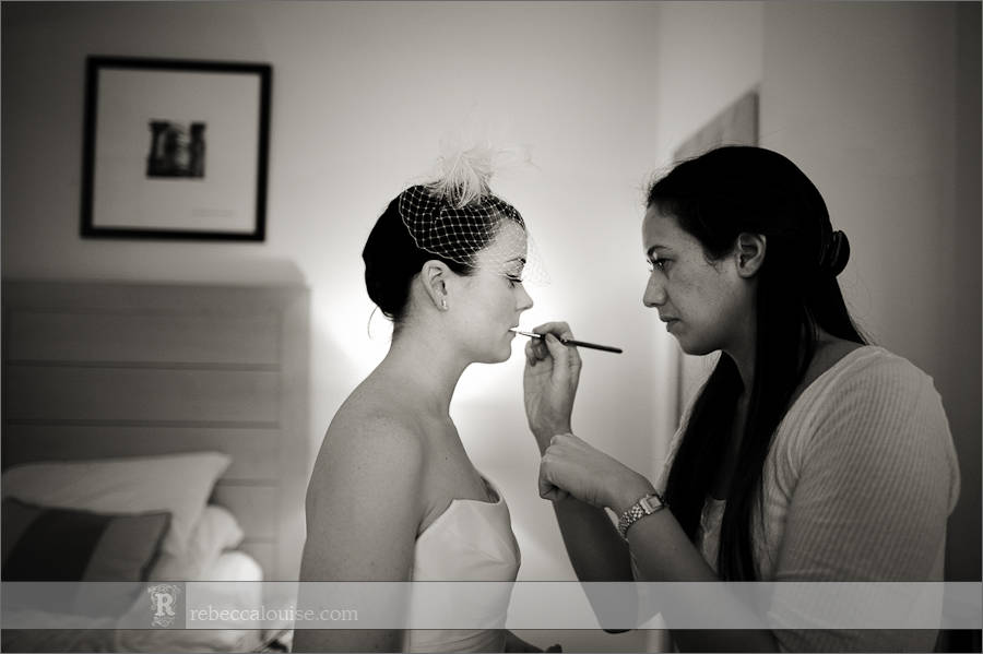 Devonport House wedding preparations - a bride has the finishing touches done to her make-up