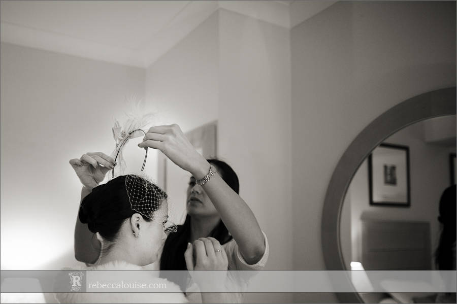 Devonport House wedding preparations - a bride has her headpiece with net attached as a finishing touch