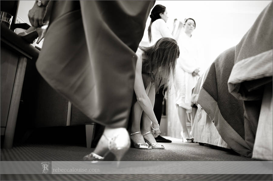 Devonport House wedding preparations - the finishing touches of shoes during the getting ready