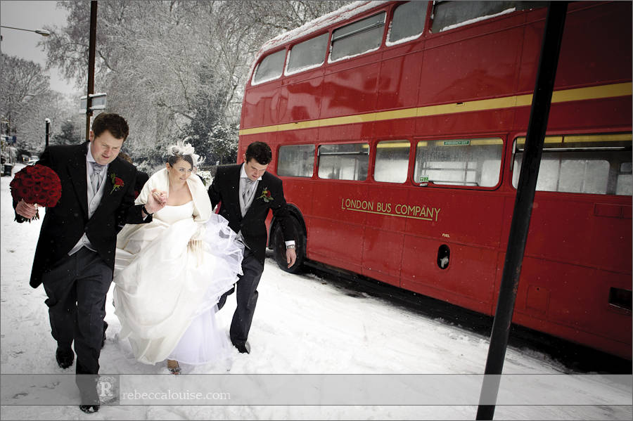 Ushers help the bride navigate Crooms Hill in the snow before her Star of the Sea Church wedding
