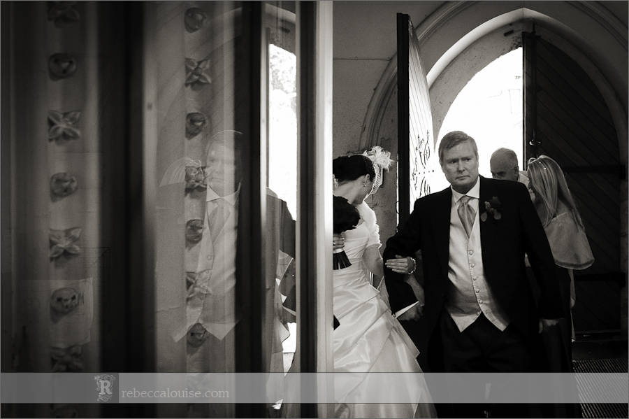 Bride and her father in the doorway before her Star of the Sea Church wedding