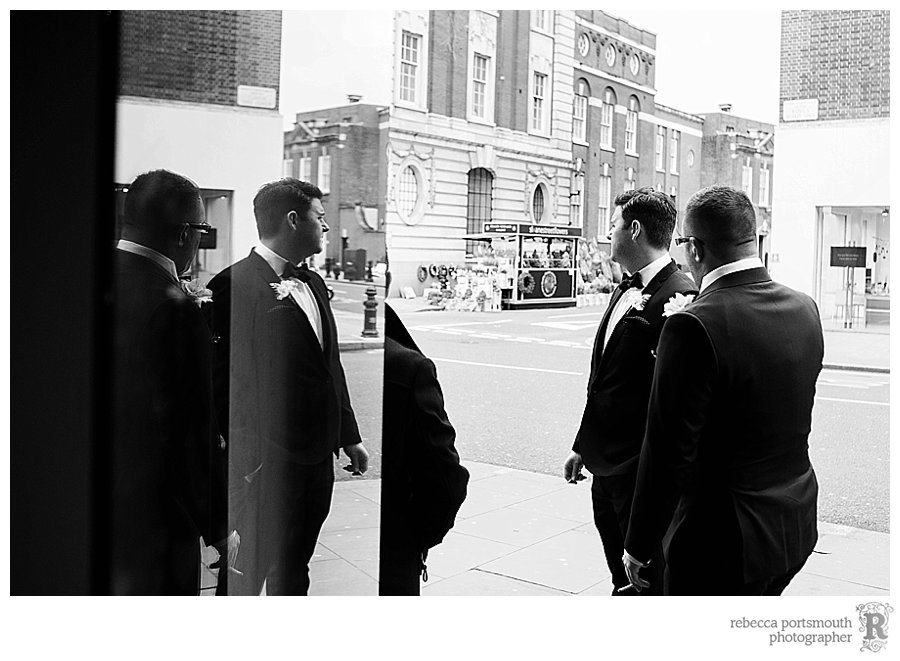 Groom james and his best man waiting before james and Kate's stylish Chelsea wedding in Chelsea Old Town Hall's Brydon Room.