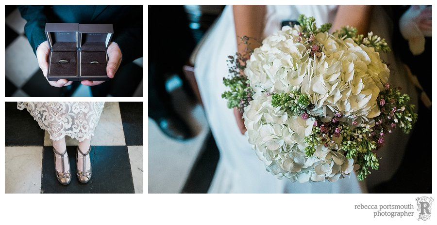 Wedding details including the bride and groom's rings held by the pageboy in the waiting room of Chelsea Old Town Hall.