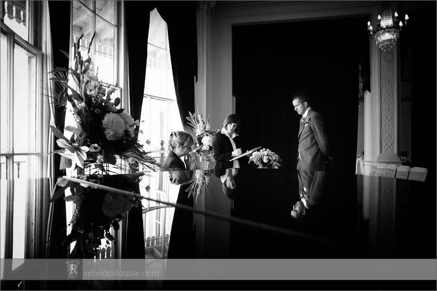 Groom Ian is interviewed by the Greenwich registrars before his summer Trafalgar Tavern wedding to Jane.