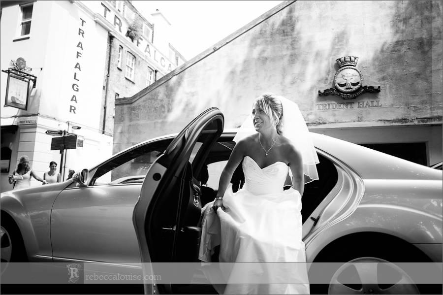 Bride Jane arrives in her full-length white gown and veil for her summer Trafalgar Tavern wedding to Ian