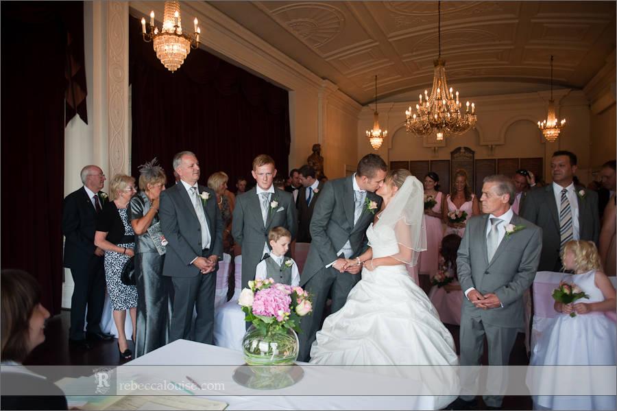 A newlywed bride and groom kiss during their Greenwich civil wedding ceremony at Trafalgar Tavern.