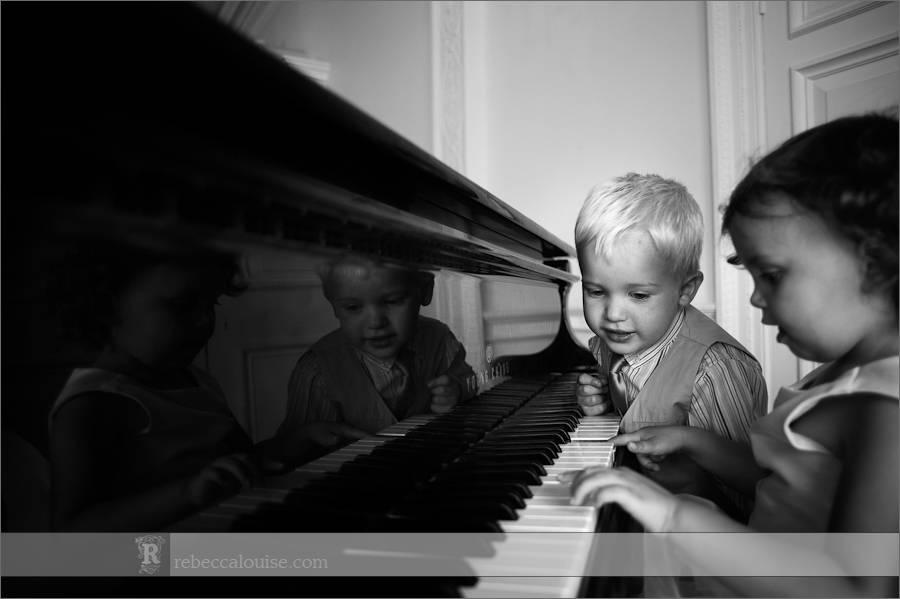 Children play on the Trafalgar Tavern's piano during Jane and Ian's summer wedding reception