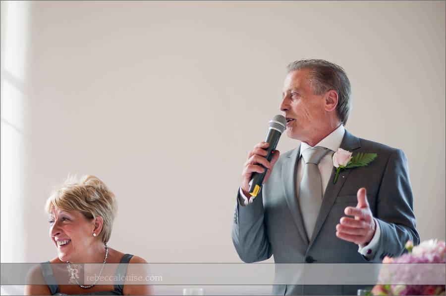 The bride's father wishes the bride and husband all the best during his speech at a Trafalgar Tavern wedding reception.