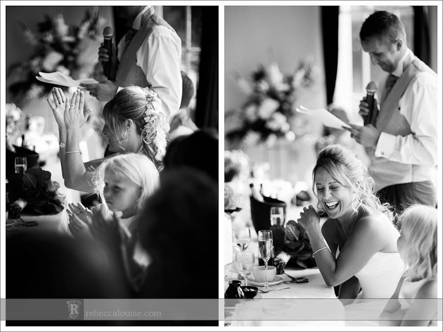 The bride claps and giggles during her new husband's speech at their Trafalgar Tavern wedding reception.
