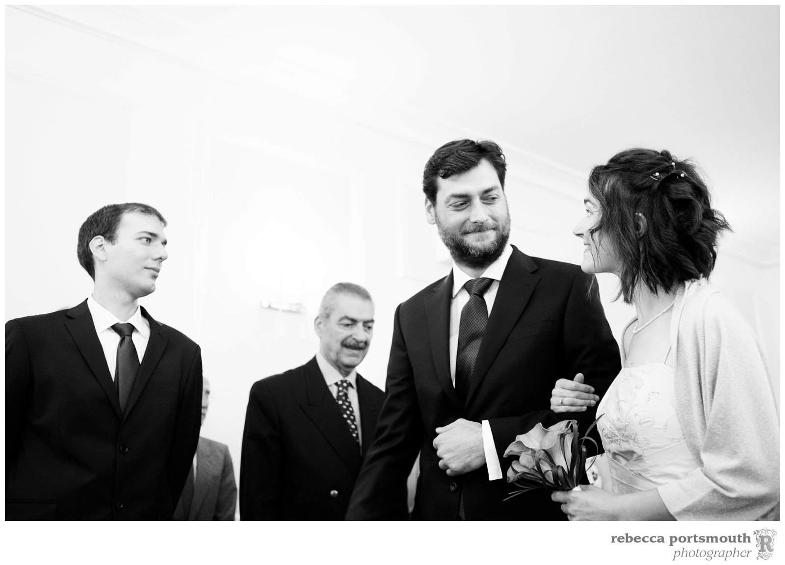The bride and groom enter the ceremony at their Cambridge Register Office wedding.