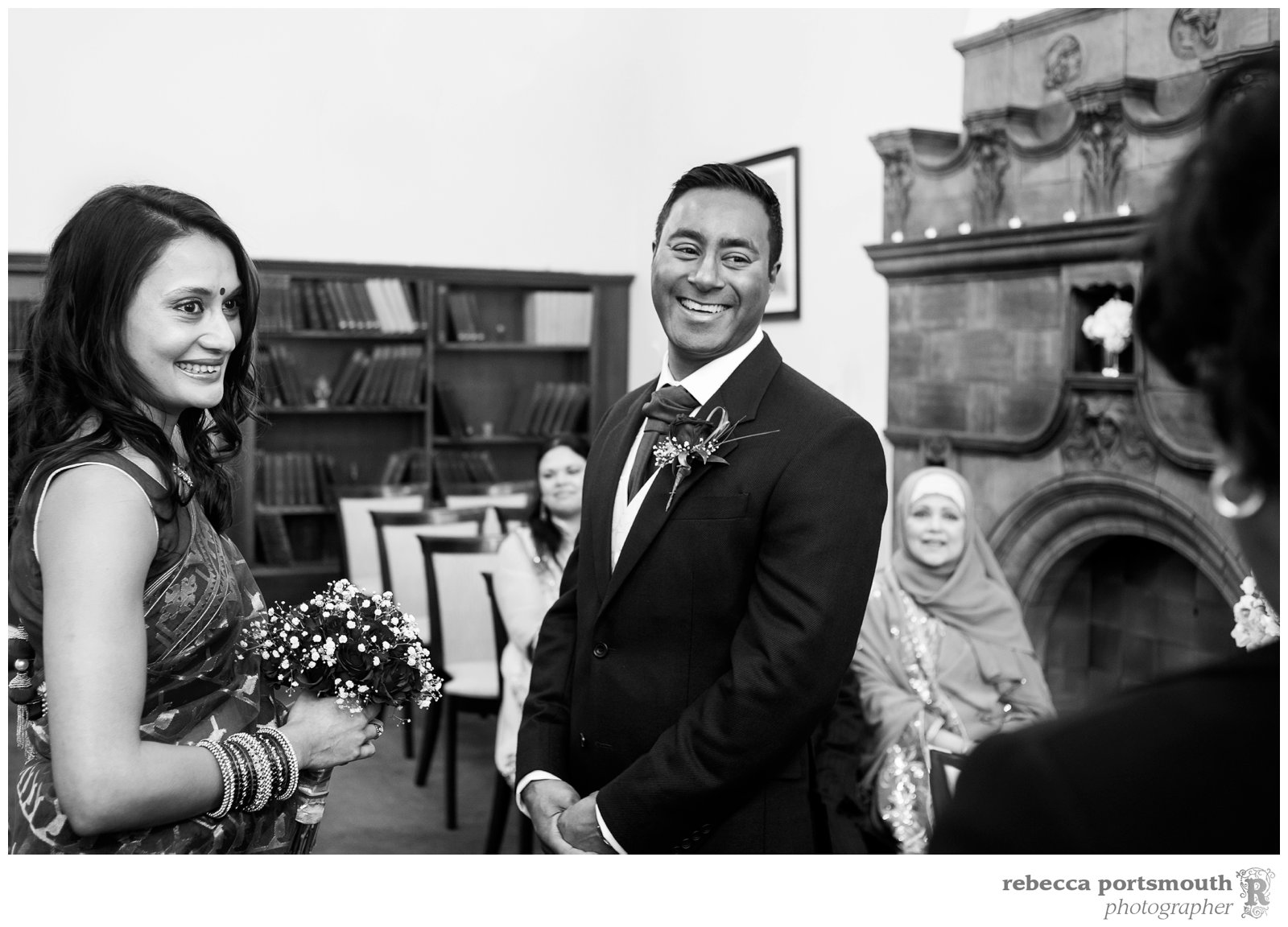 Bride Tas and groom Ravi are all smiles at their Marylebone Room  wedding officiated by Westminster registrar Patricia Gordon.