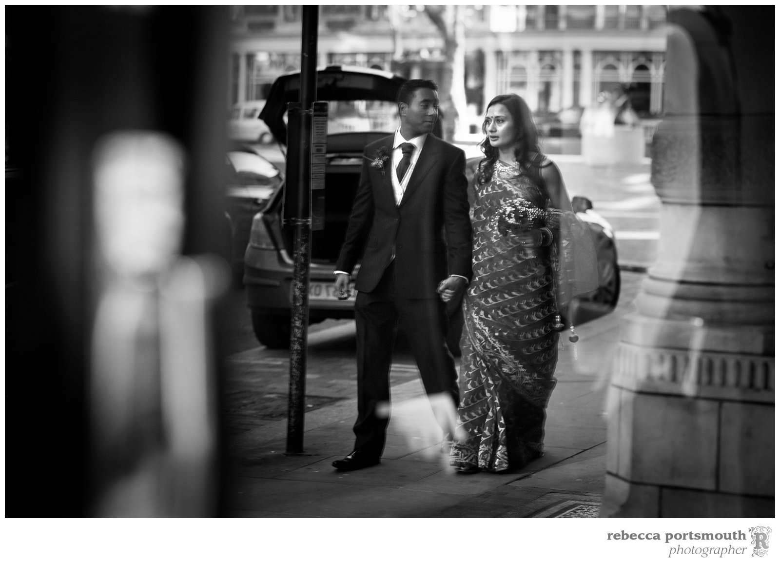 The reflection of a bride and groom as they stroll through Mayfair's Mount Street to their wedding breakfast nearby.