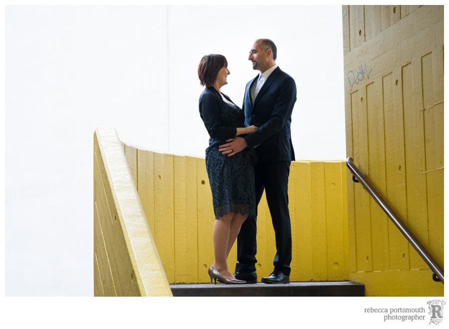 Bride and groom on yellow steps on London's South Bank for their wedding portraits