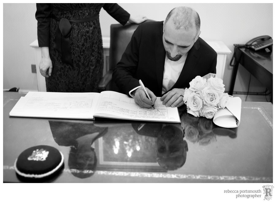 Harrington Room wedding register signing with reflection in the desktop (London register office civil wedding)