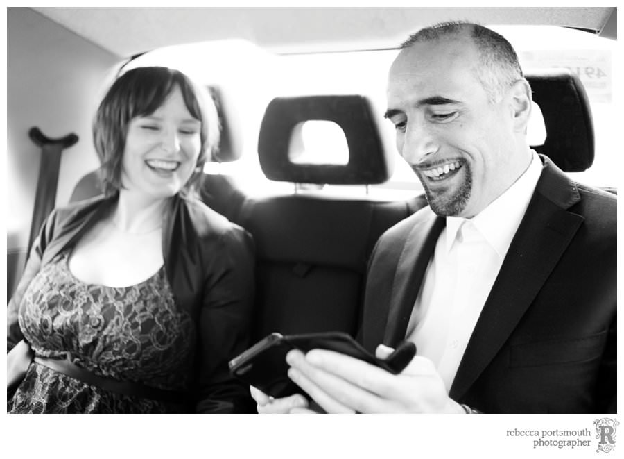 Bride and groom Monika and Giovanni take a black cab to their wedding portraits on the south bank