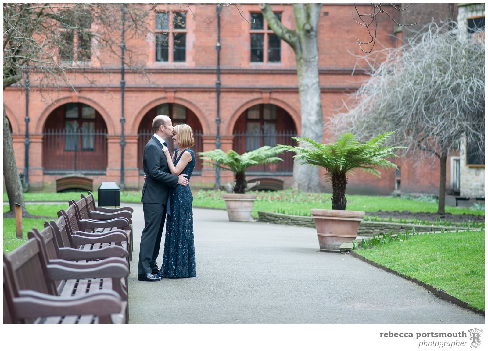 Emma and Chris have their wedding portraits taken in Mount Street Gardens before their London vow renewal in the adjacent Mayfair Library.