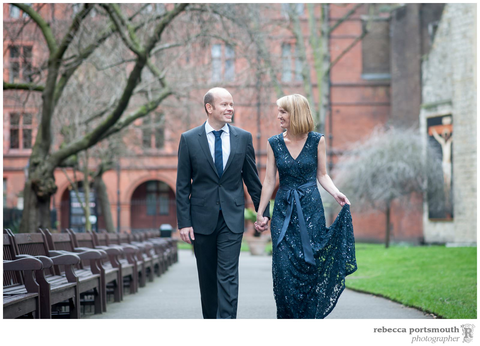 A bride wears a full-length navy lace gown for her vow renewal in bridal portraits in London's Mount Street Gardens.