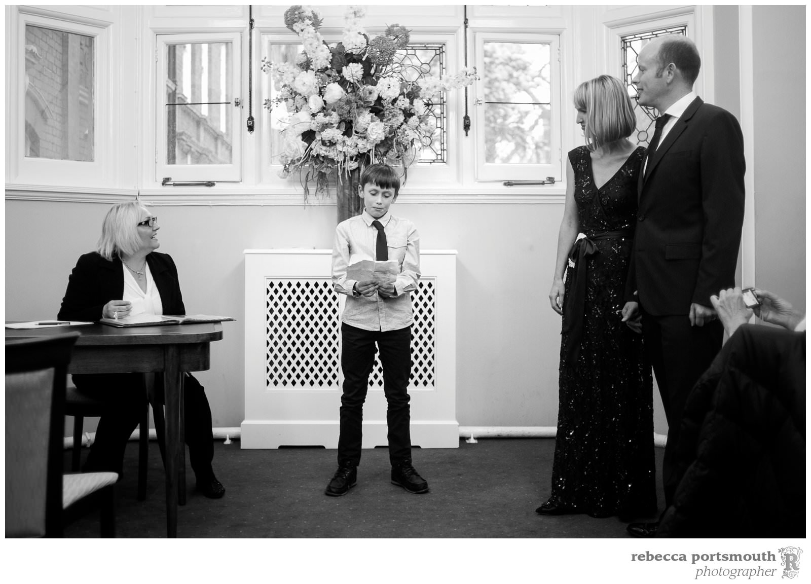 A young guest does a reading during a London vow renewal at Westminster's Mayfair Library.