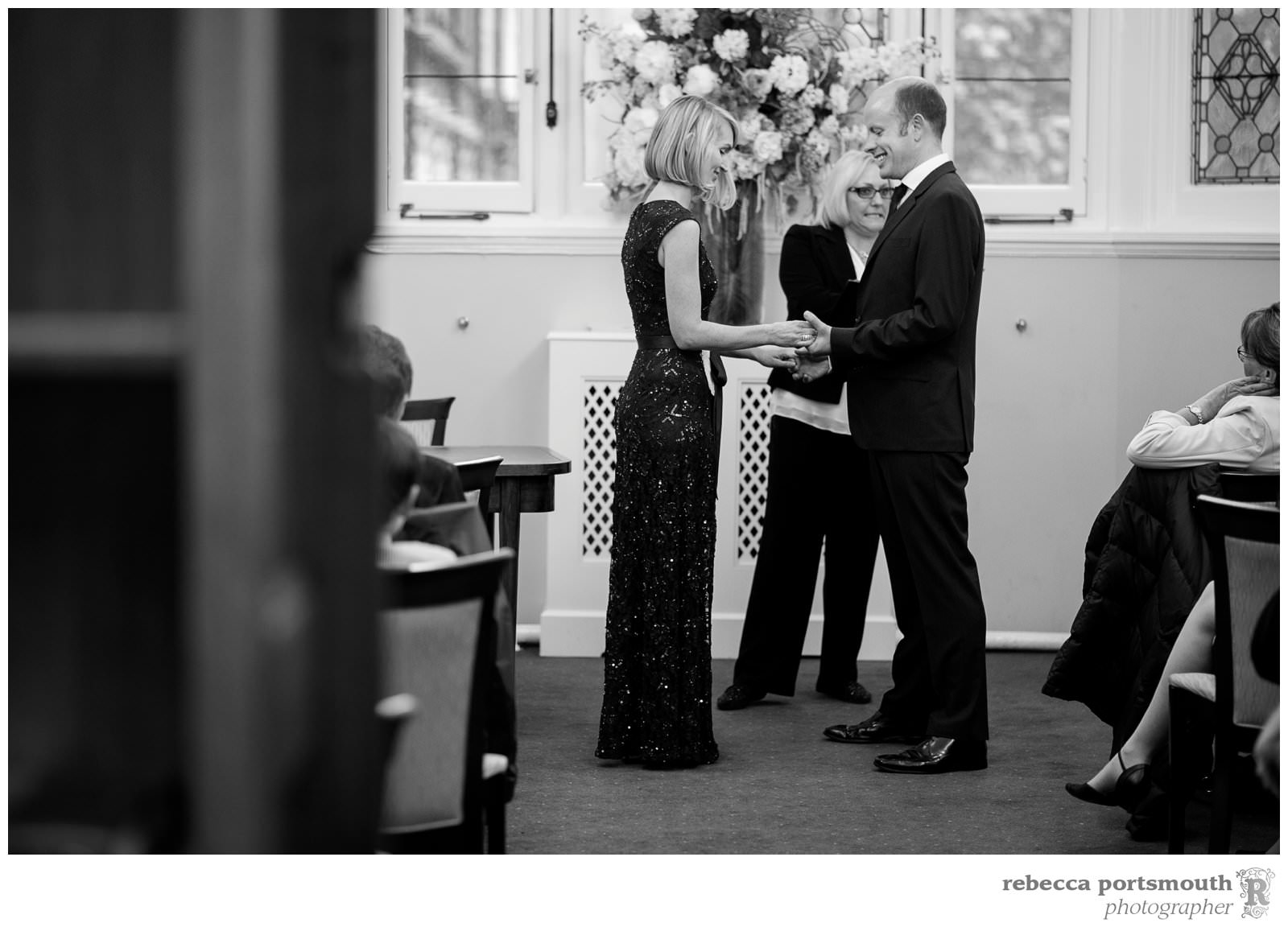 A bride and groom exchange rings in a vow renewal at Mayfair Library, in South Audley Street, London.