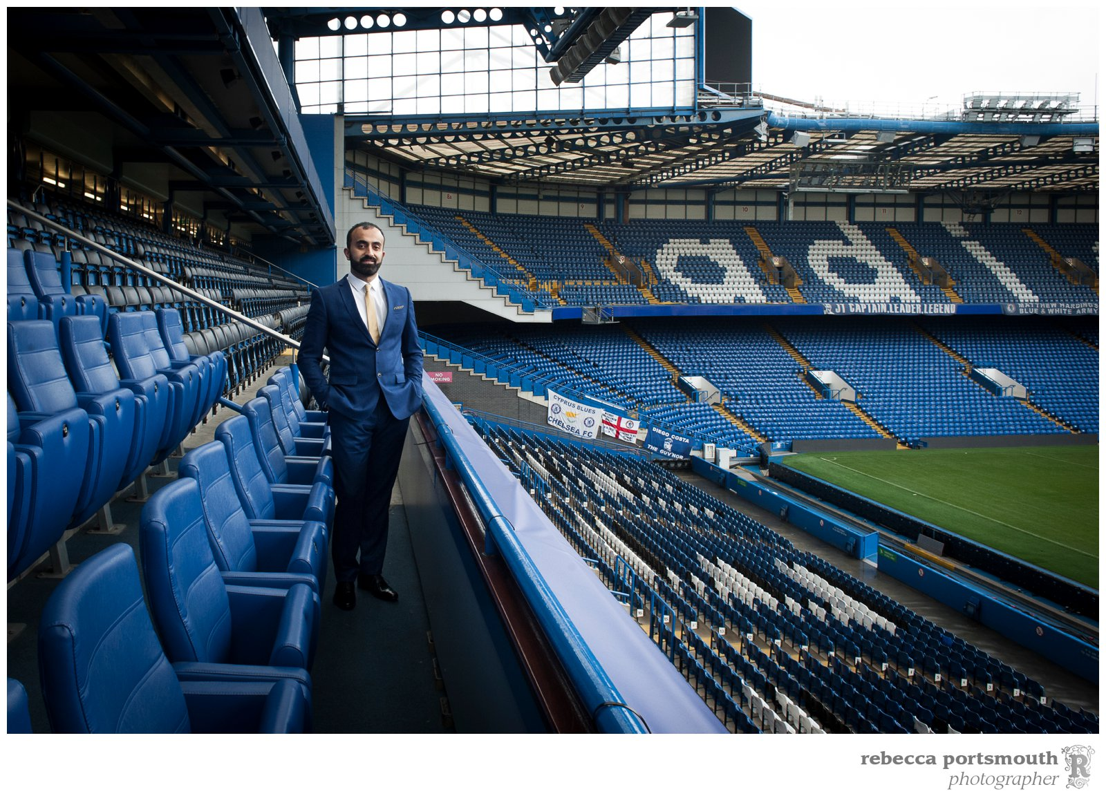Portraits of the groom in the stands at his Chelsea Football Club wedding