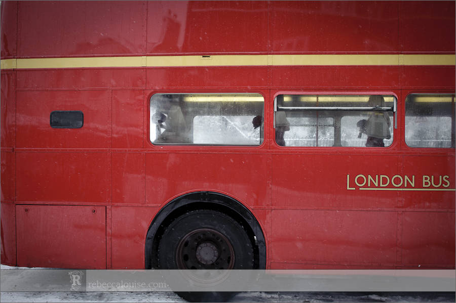 The bride and her bridesmaids arrive for her Star of the Sea Church wedding in a red London Routemaster bus.
