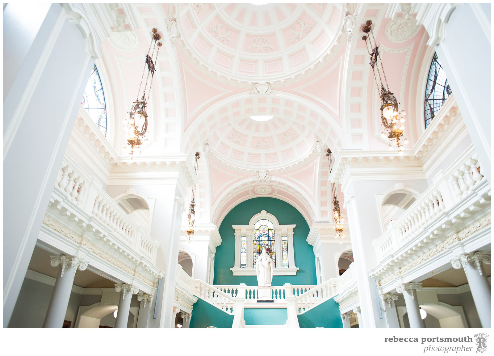 The pink and white painted ceiling of Victoria Hall in Woolwich, SE18, London, home of the Royal Borough of Greenwich and where civil wedding ceremonies take place.