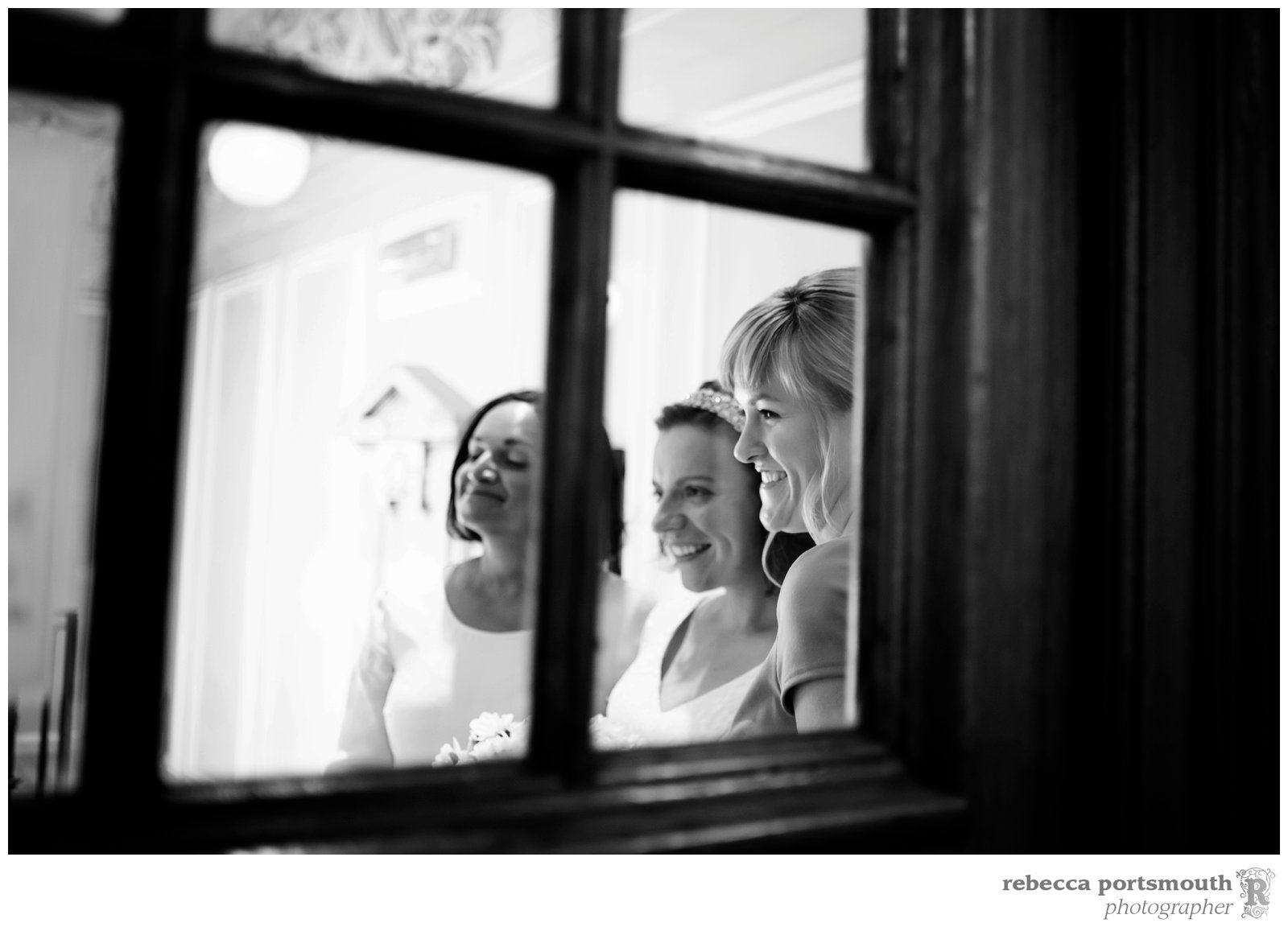 A bride and her bridesmaids arrive at Woolwich Town Hall for her Greenwich Register Office wedding ceremony.