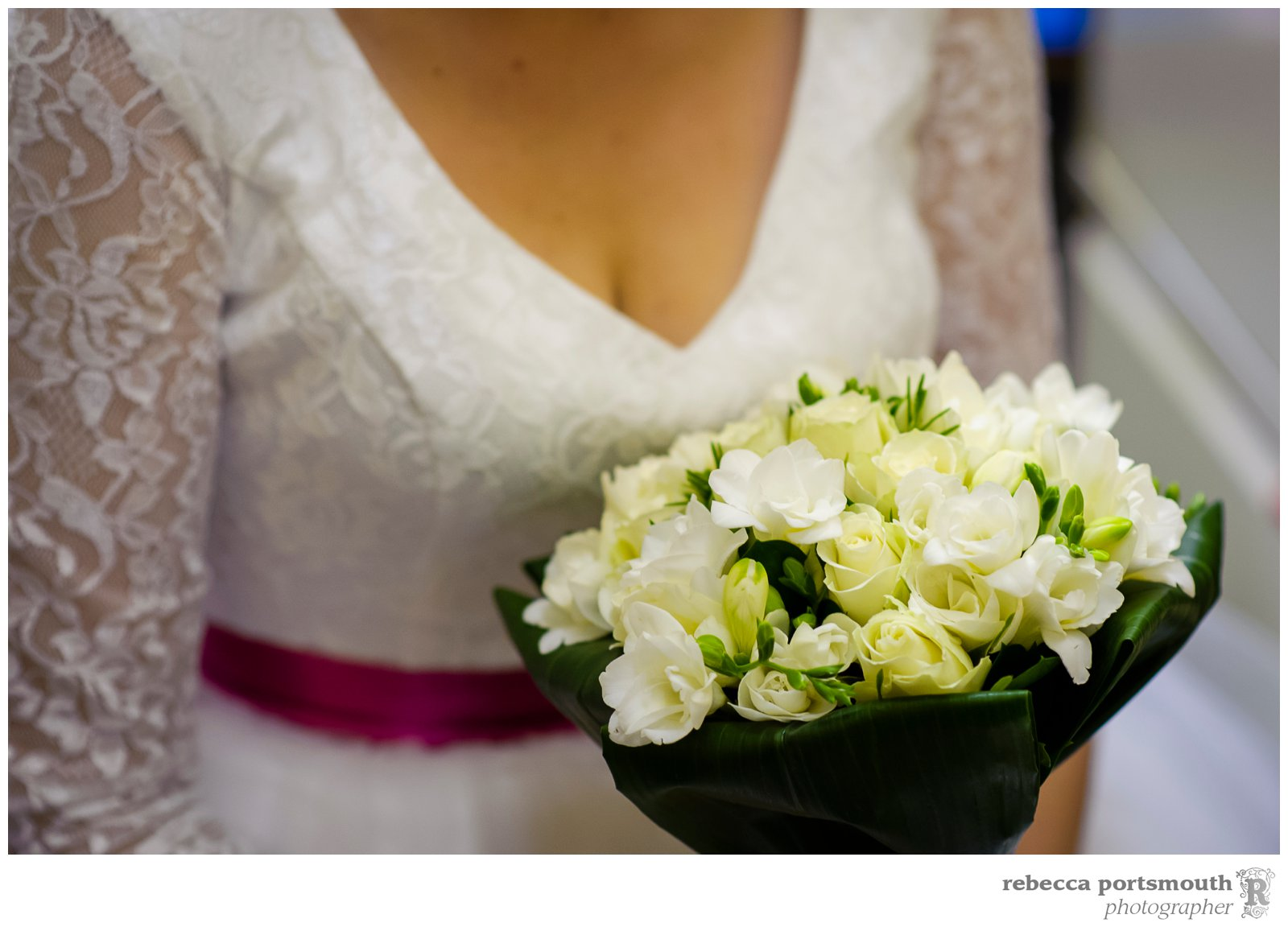 A bride and her white wedding bouquet at Victoria Hall in the Woolwich Town Hall, home of Greenwich Registry Office.