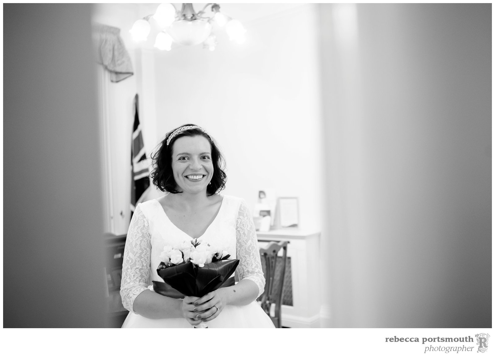 The bride with her bouquet - waiting to go into the ceremony room at Woolwich Town Hall in the Royal Borough of Greenwich.