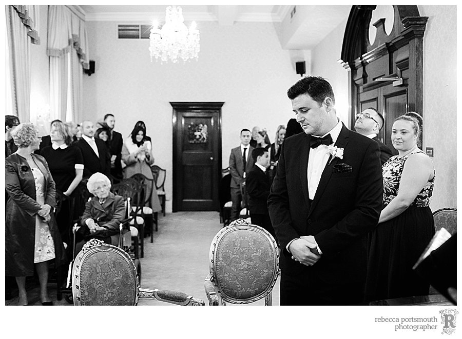 Groom James waits patiently for his glamorous bride Katie to walk through the door of the Brydon Room for their civil wedding.