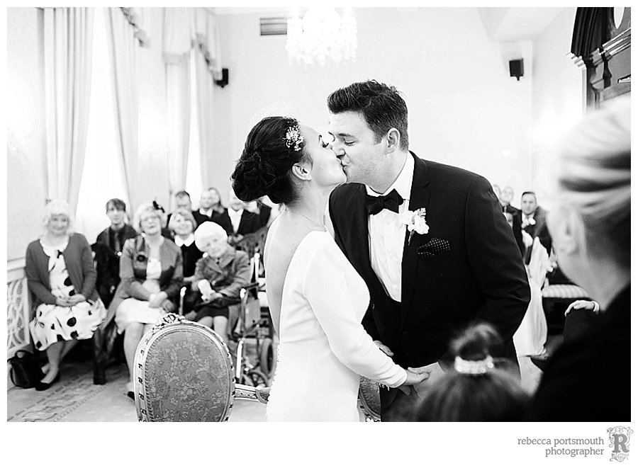 The bride and groom kiss once they are announced and man and wife during their Brydon Room wedding ceremony.